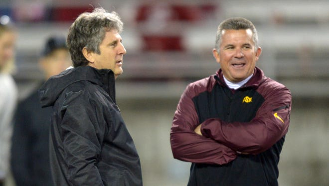 Washington State Cougars coach Mike Leach (left) and Arizona State Sun Devils coach Todd Graham talk before a game at Martin Stadium.