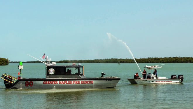 Newly launched Greater Naples Fire /Rescue Boat 90 and its sister Rescue Boat 60 from Everglades City pass in review for in-service and wet-down in front of the crowd of people gathered for the Boat 90 dedication service on the Isles of Capri.