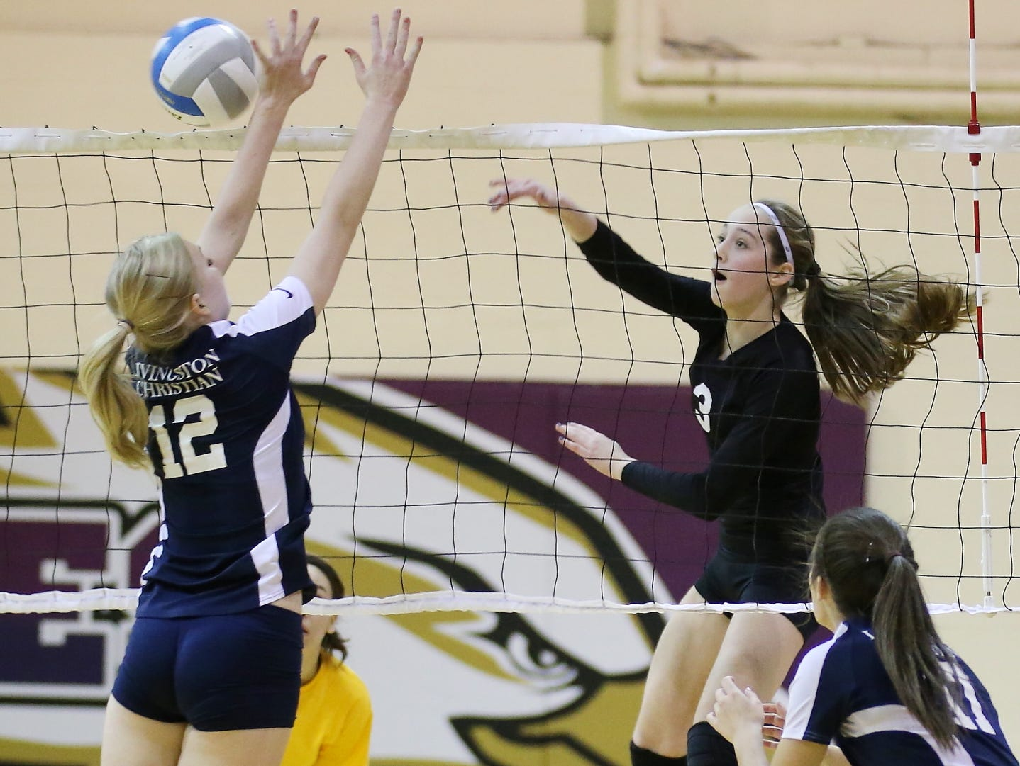 Hammering a spike over the outstretched arms of Livingston Christian's Sarah Wenger (No. 12) is PCA's Grace Kellogg (No. 3).