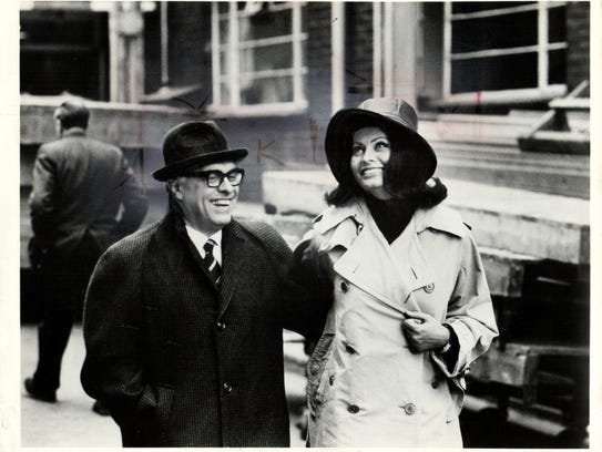 Producer Carlo Ponti and his wife SOPHIA LOREN, take