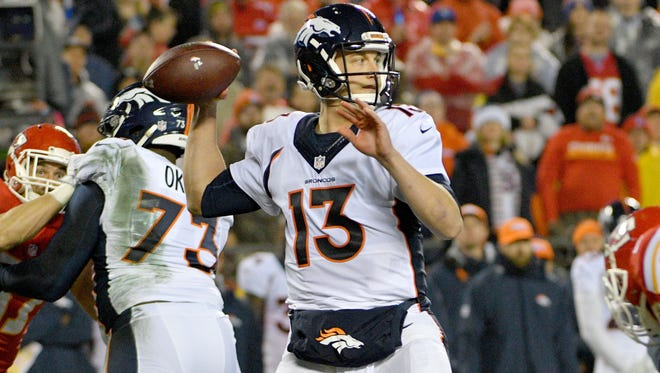 Denver Broncos quarterback Trevor Siemian (13) throws a pass during the first half against the Kansas City Chiefs at Arrowhead Stadium on Christmas Day. Siemian will have surgery on his left shoulder this week.
