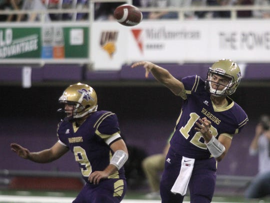 Norwalk junior quarterback Brady Brandsfield fires a pass against Pella. Norwalk fell 31-17 to Pella in the Class 3-A championship game Nov. 19 at the UNI-Dome in Cedar Falls.