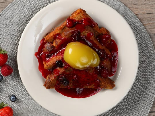 Cinnamon brioche French toast with warm berry compote at Wildflower Bread Company.