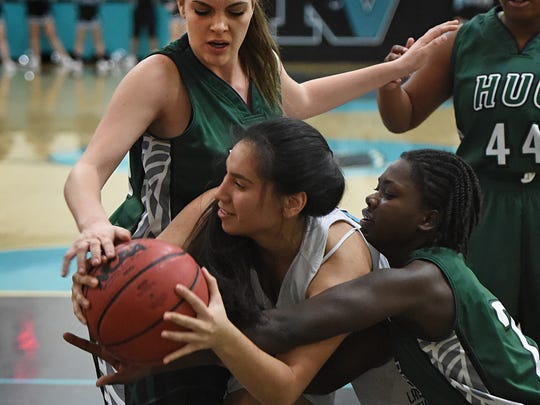 North Valleys' Karina Madera, center, is double-teamed by Hug's Emilee Heath, left, and Rionna Haymon during Tuesday's game at North Valleys.