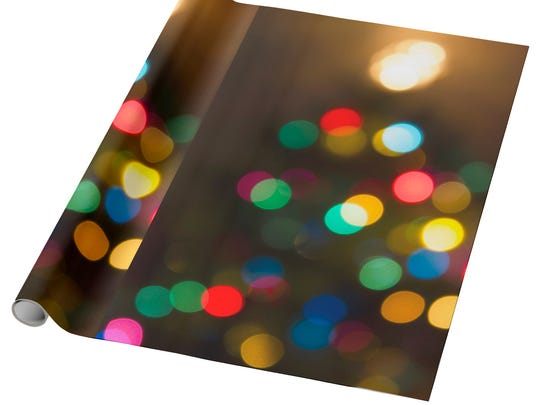 In this photo provided by Zazzle, sparkly holiday lights at night inspired this dramatic wrapping paper design from Zazzle designer AeshnidaAesthetics. (Zazzle via AP)