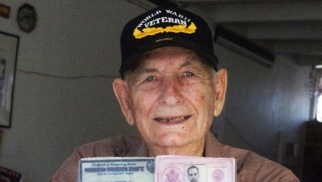 Larry Herrin Jr., 90, a native of El Paso, was 18 years old when he witnessed the Japanese delegation board the USS Missouri and sign the surrender document from his perch aboard the USS Ancon, anchored near the Missouri in Tokyo Bay on Sept. 2, 1945. He holds his military service identifications.