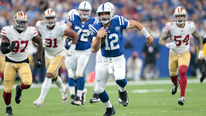 Indianapolis Colts quarterback Andrew Luck (12) scrambles away from San Francisco 49ers linebacker Dekoda Watson (97), defensive end Arik Armstead (91) and defensive end Cassius Marsh (54) in the first half of an NFL preseason football game in Indianapolis, Saturday, Aug. 25, 2018. (AP Photo/AJ Mast)