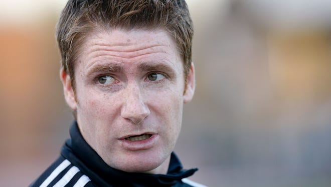 Louisville FC's head coach James O'Connor watched his team play U of L during their soccer match at U of L.March 11, 2015