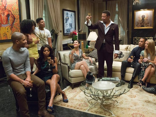 Lucious (Terrence Howard) toasts his family in the