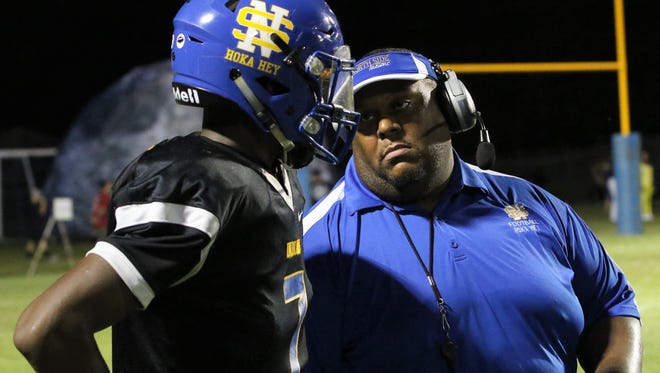 North Side head coach Jesse Powell talks with one of his players against Milan on Sept. 7, 2018.