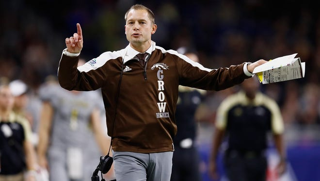 Head coach P.J. Fleck looks on from the sideline during the first half while playing the Ohio Bobcats during the MAC Championship on December 2, 2016 at Ford Field in Detroit, Michigan. (Photo by Gregory Shamus/Getty Images)