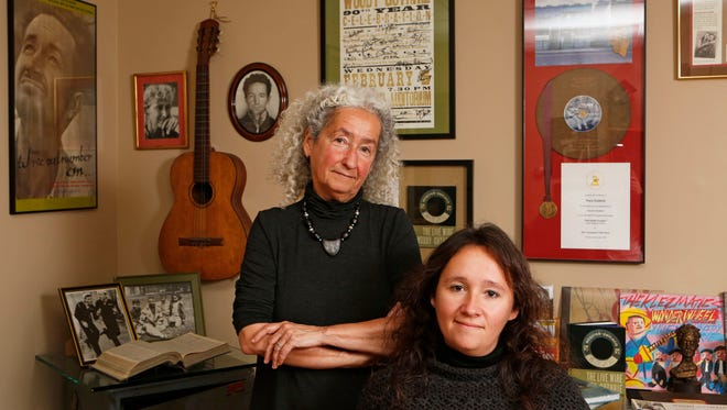 """Nora Guthrie, daughter of Woody Guthrie, keeps his legacy alive with the help of her daughter, Anna Canoni. Nora Guthrie recently released an audio book she wrote called, """"My Name is New York: Ramblin' Around Woody Guthrie's Town."""" Nora Guthrie, left, and her daughter Anna Canoni are photographed at the Woody Guthrie Archives, Nov. 12, 2014 in Mount Kisco."""