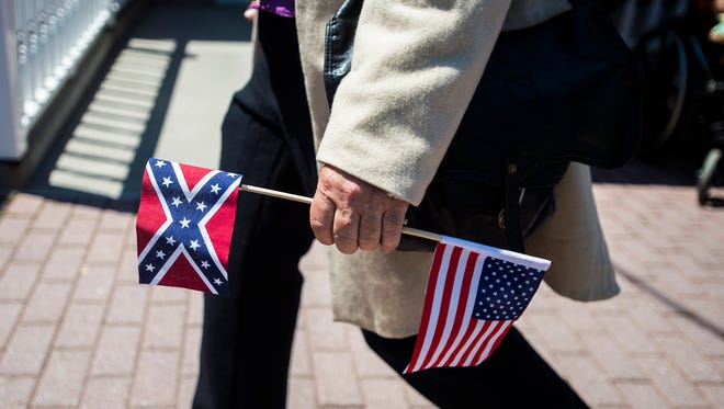 In this file photo, marchers protest the removal of a Confederate flag in downtown Gettysburg Saturday July 11, 2015.