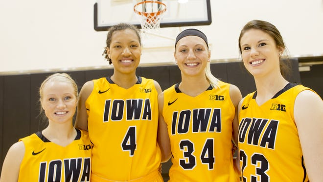 From left at media day, Iowa's freshmen women's basketball players: Whitney Jennings, Chase Coley, Carly Mohns and Christina Buttenham.