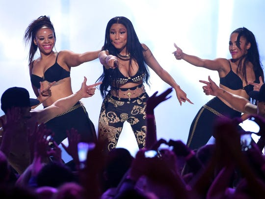 Nicki Minaj (center) performs with dancers during the