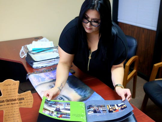 Marina Garcia looks through a photo album of her son Josiah Christian Cantu on April 11, 2017, in Corpus Christi. Cantu died from a gun shot wound in the stomach last year. Corpus Christi Police initially said Cantu shot himself, but a year later Nueces County District Attorney Mark Gonzalez is seeking a criminal indictment against a friend.