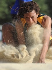 John Moore of Royal competes in the boys long jump at the Ventura County Track and Field Championships on Friday at Moorpark High.
