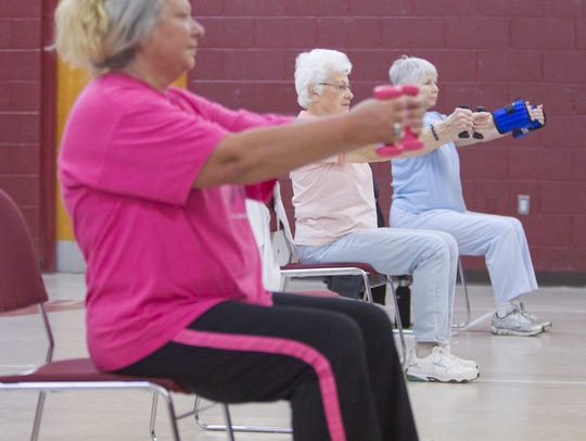 Participating in the Howell Senior Center Stretch and
