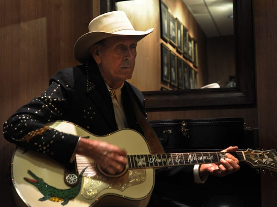 Jimmy C. Newman warms up backstage at the Grand Ole Opry before singing a tribute to old friend George Jones in April 2013.