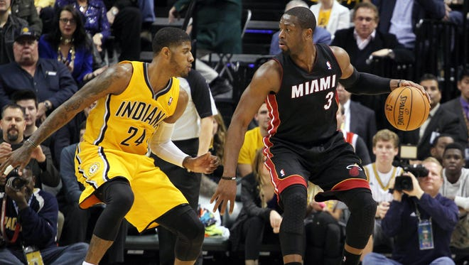 Miami Heat guard Dwayne Wade (3) is guarded by Indiana Pacers forward Paul George (24) in the first meeting. The two square off again tonight.