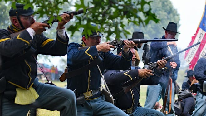 In this 2019 file photo, Union soldiers fire as they advance during the Heritage Days Battle at Pea Ridge at Lake Storey in Galesburg.
