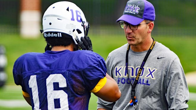 Knox College football coach Damon Tomeo goes over plays with Jeremiah Mathews during practice Sept. 11, 2019 at the Knosher Bowl in Galesburg.