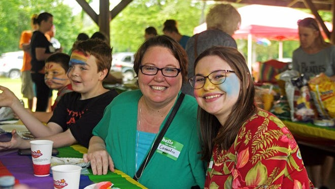 Cassandra Hunt of Galesburg and Grace Robbins of Victoria enjoy a meal at the 2019 Pride Picnic at Lake Storey.