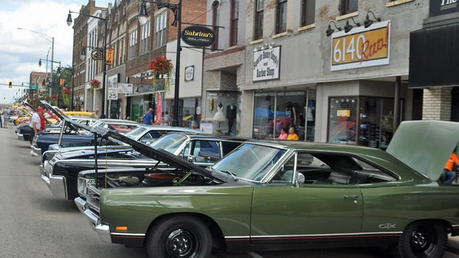 Cars line the street during the River 2 River Car Cruise Friday night on Main Street in Galesburg.