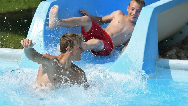 In this file photo from July 18, 2019, a pair of patrons cool down on the slide at Lakeside Water Park at Lake Storey in Galesburg.