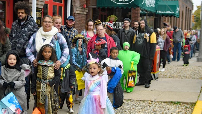 Kids dressed in their costumes wait in line for Treat Street bags and to register for prizes at WGIL during Galesburg's 2019 Treat Street. Due to the COVID-19 pandemic and the need to avoid large crowds, this year's event will take place over the course of a week, from Oct. 24 to Oct. 31.