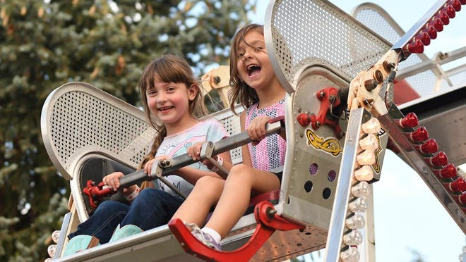 FILE PHOTO: Makayla Forshee and Rylie Johnson, both 6 and from Galesburg, take a ride on the Ferris wheel at the Galesburg Railroad Days carnival on Main Street in 2019. After being canceled in 2020, Railroad Days runs Thursday through Sunday next week.
