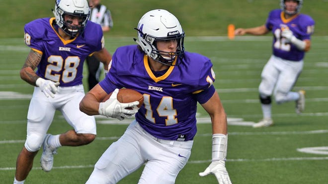 Knox College receiver Hunter Lee catches a pass and heads up field during a home game against Iowa Wesleyan University on Saturday, Sept. 14, 2019.