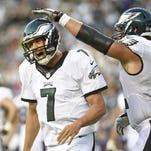 Sam Bradford (7) celebrates a touchdown with center Jason Kelce (62) against the Baltimore Ravens on Saturday.