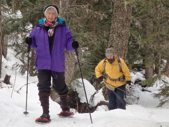Snowshoers enjoying the trails behind the resort.