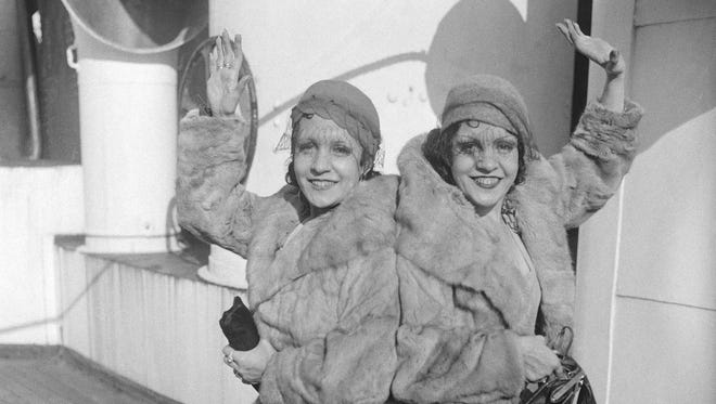 Violet and Daisy Hilton, conjoined twins, are pictured upon their arrival in New York, Oct. 6, 1933.