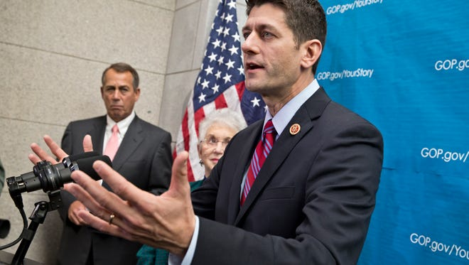 House Budget Committee Chairman Paul Ryan, R-Wis., right, joined by Speaker of the House John Boehner, R-Ohio, left, and Rep. Virginia Foxx, R-N.C., answers reporters' questions at the Capitol in Washington on Dec. 11, 2013.