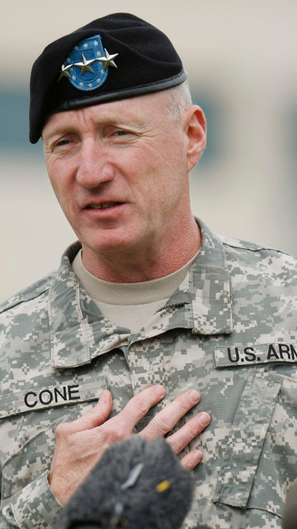 Then Lt. Gen. Robert Cone gestures during a news conference