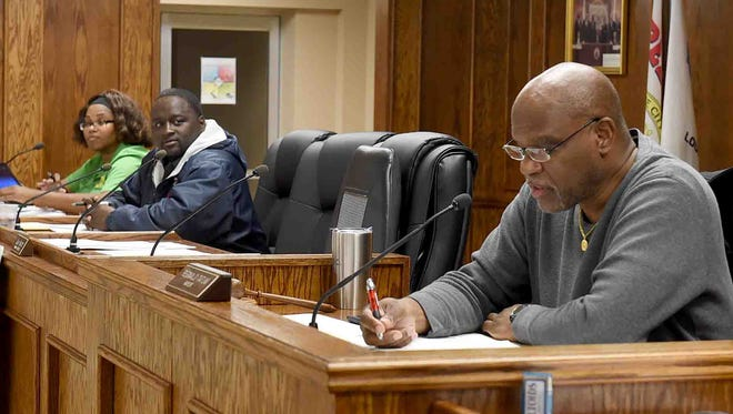 Mayor Reggie Tatum and Councilman Marvin Richard and Blair Briggs, not pictured, wait on a quorum to begin Tuesday's city council meeting.