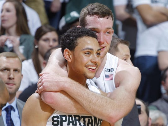 MSU coach Tom Izzo said Bryn Forbes, left, and Matt Costello have worked out for between 10 to 12 NBA teams in preparation for Thursday's draft.