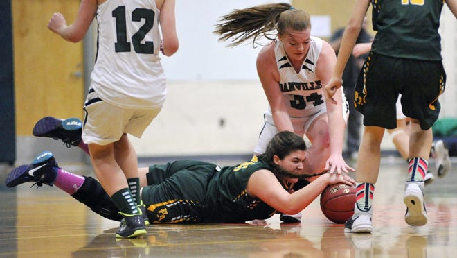Peoples Academy sophomore Brandi Small dives for a loose ball against Danville senior forward Britani Buck during the first half Thursday night.