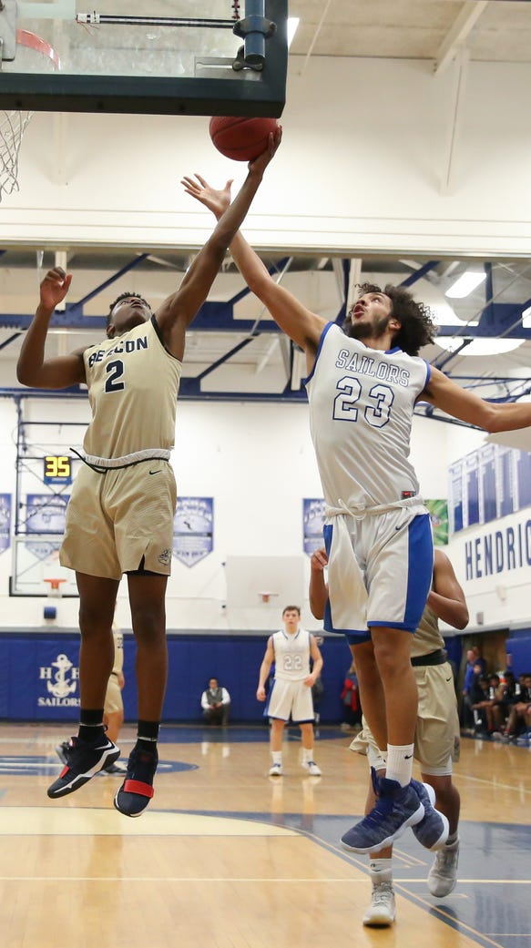 Beacon's Dayion Thompson (2) puts up a shot as Hen
