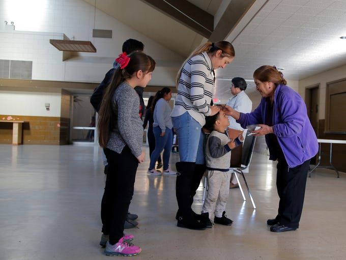 A young boy receives ashes at St. Mary of the Nativity