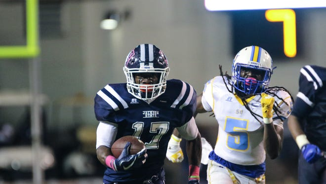 Jackson State tailback Jordan Johnson runs away from a Southern defender Saturday night at Memorial Stadium