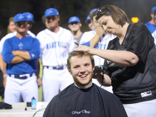 UNCA baseball player Joe Gruszka smiles as his head