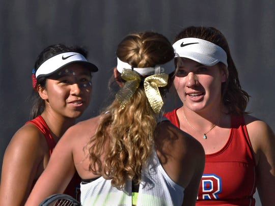 Reno High's tennis doubles partners Jazlyn Parker, left, and Jill Rovetti, right, shake hands an opponent after a recent doubles game at the Caughlin Ranch Athletic Club.