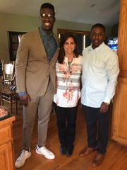 Dorial Green-Beckham on the night he was drafted by the Titans, standing in the kitchen with his adoptive mother, Tracy Beckham, and his cousin, Mikael Falls-Cooper, who will live with Green-Beckham in Nashville.