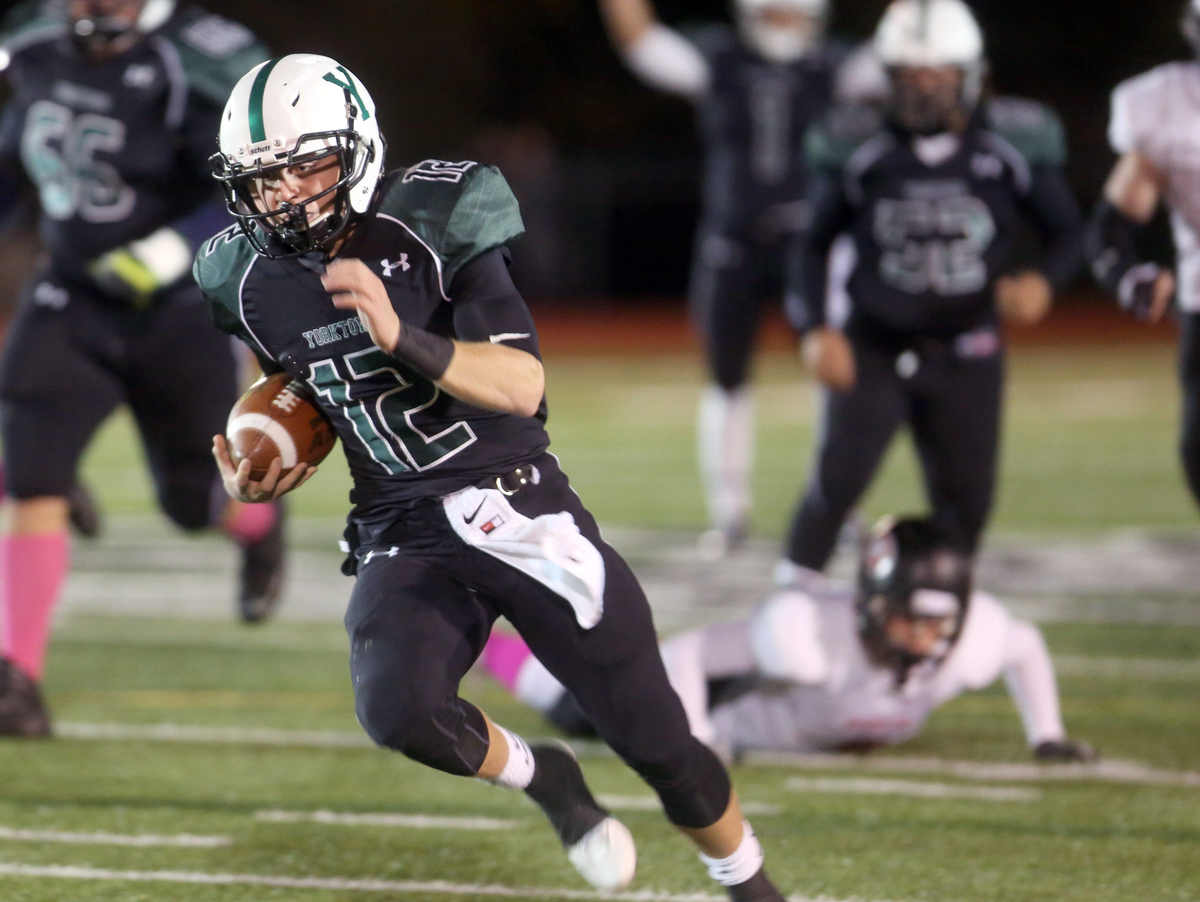 Yorktown quarterback Jose Boyer breaks free for a 50-touchdown run during the first quarter of a Class A semifinal football game against Rye at Yorktown High School Oct. 28, 2016. Yorktown defeated Rye 66-42.