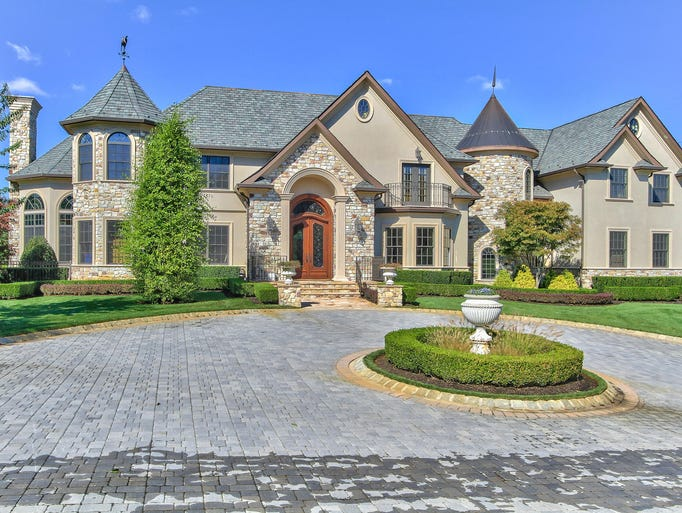 Emerge from a private road to this fabulous French chateau at 63 Crine Road.