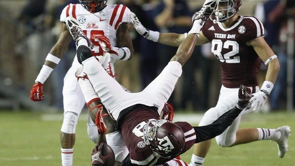 Ole Miss linebacker Serderius Bryant makes a tackle against Texas A&M.