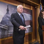 In this Feb. 24, 2016 file photo, Senate Armed Services Committee Chairman Sen. John McCain, R-Ariz., left, accompanied by committee members Sen. Kelly Ayotte, R-N.H., center, and Sen. Lindsey Graham, R-S.C., participate in a news conference on Capitol Hill in Washington.
